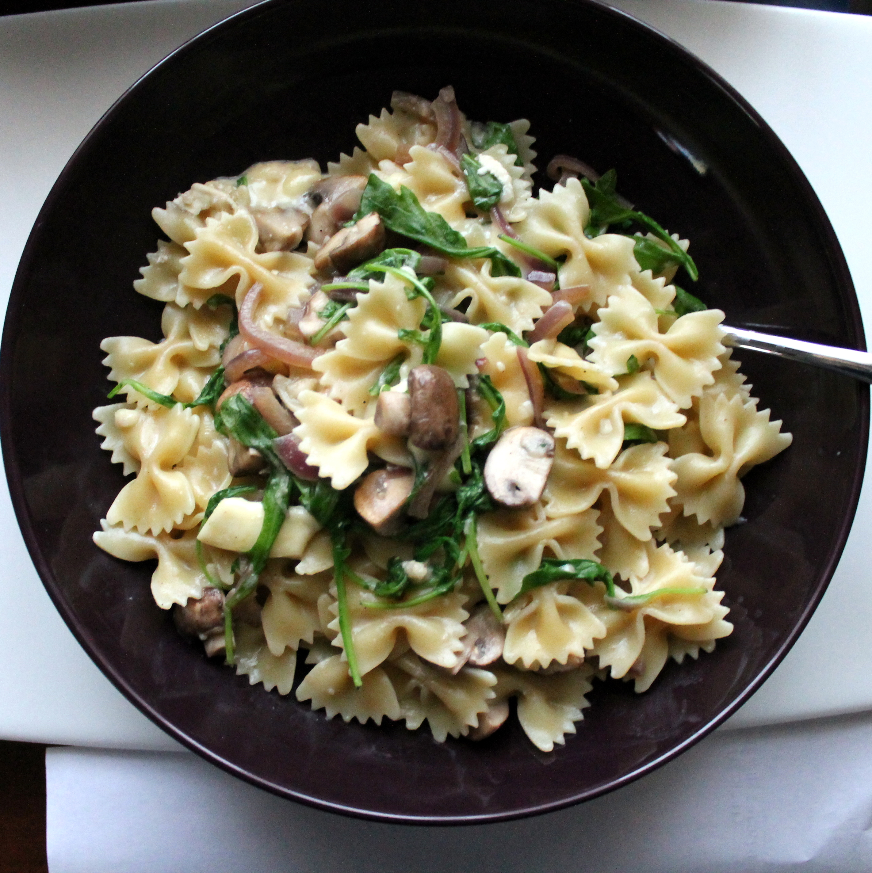 ... pasta is coated. Stir in the mushroom mixture and arugula and serve