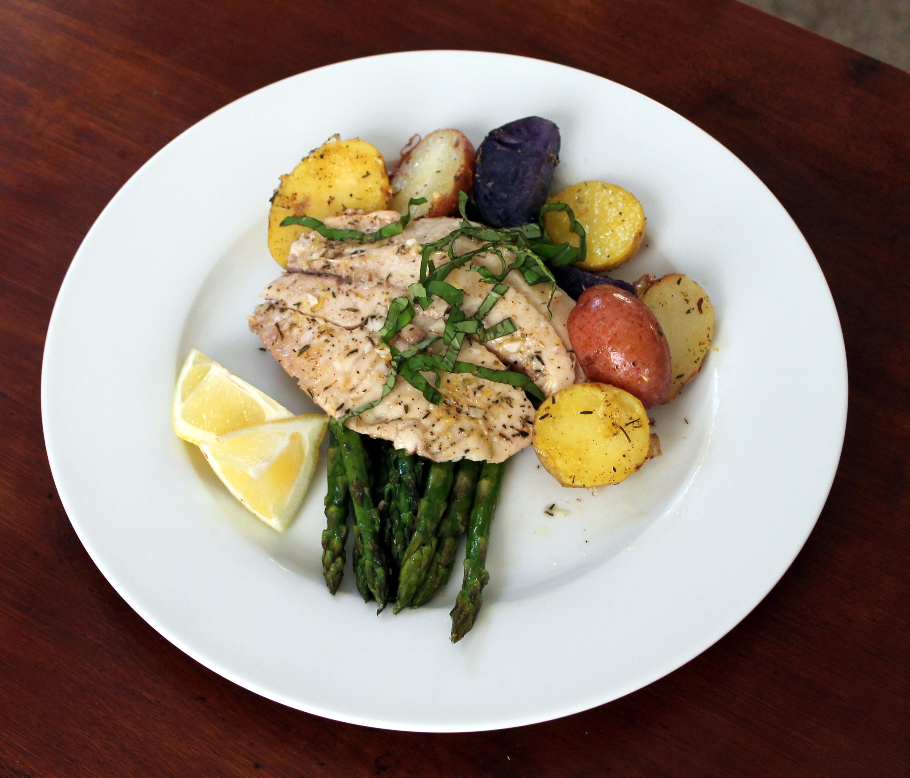 Simple baked tilapia asparagus and potatoes the kitchen for How to cook baked fish